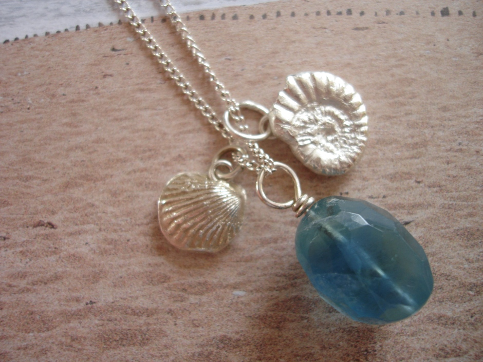 Ammonite and shell silver